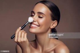 Beautiful woman applying make-up
